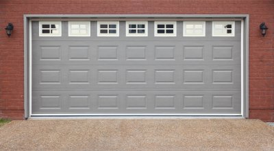 brick house with grey garage door